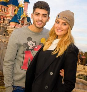 Caption Celebrity couple Zayn Malik and Perrie Edwards celebrate Zayn's 21st birthday with a visit to Disneyland Paris. The Little Mix singer surprised her fiancé Zayn, with a magical getaway to the fairy-tale Disneyland Hotel, including a special visit from Disneyland Paris' most famous resident Mickey Mouse. Their favourite attractions included Big Thunder Mountain and Peter Pan's Flight as well as the parks night-time fireworks spectacular Disney Dreams. www.disneylandparis.co.uk